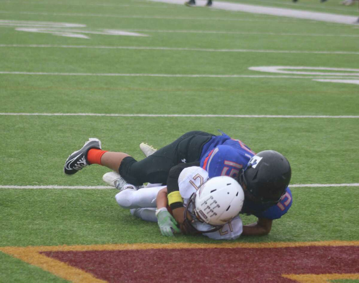 Sophomore Seminoles player Jacob Hood falls into the end zone for a 16-yard touchdown reception that helped get the team within 12-7 for halftime Saturday. But that's as close as the Broncos would let them get.