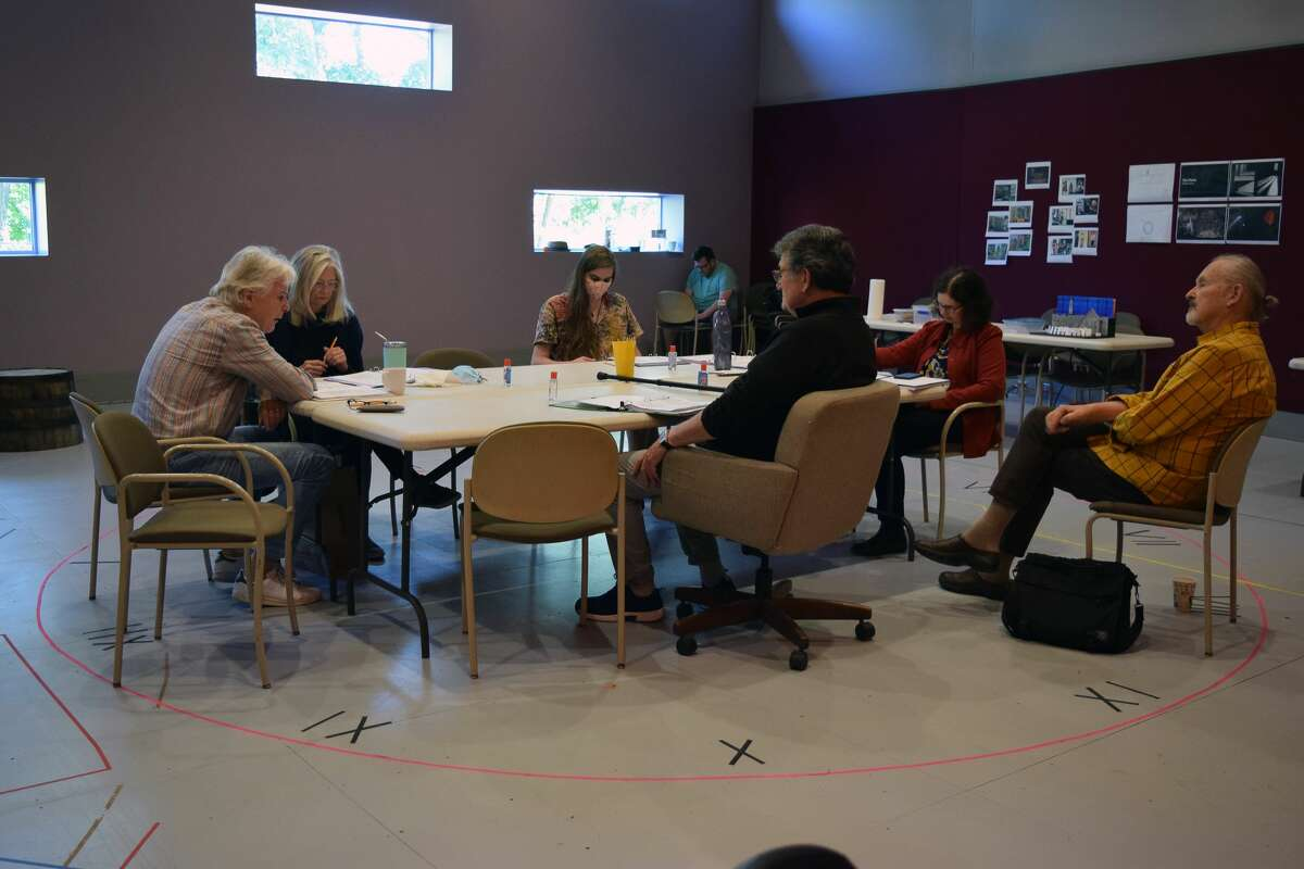 """Members of cast and crew discuss """"The Chairs"""" during the first day of rehearsals. (Shakespeare & Company)"""