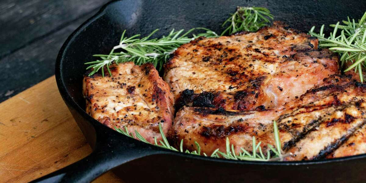 A sprig of rosemary adds a pop of flavor to grilled porkchops.
