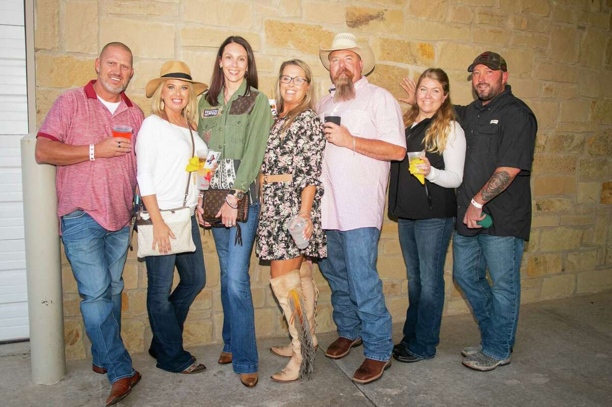 """Left to right Andrew Talley, Tess Talley, Wylea Brown, Kim Stewart, John Stewart, Amanda Lay and Daniel Lay pictured during the """"West Texas Festival"""";  Beer, wine and spirits tasting benefiting the Ellen Noel Art Museum on October 1, 2021 at the Midland Shooters Association Shotgun Range clubhouse.  MANDATORY CREDIT: The Oilfield Photographer, Inc."""