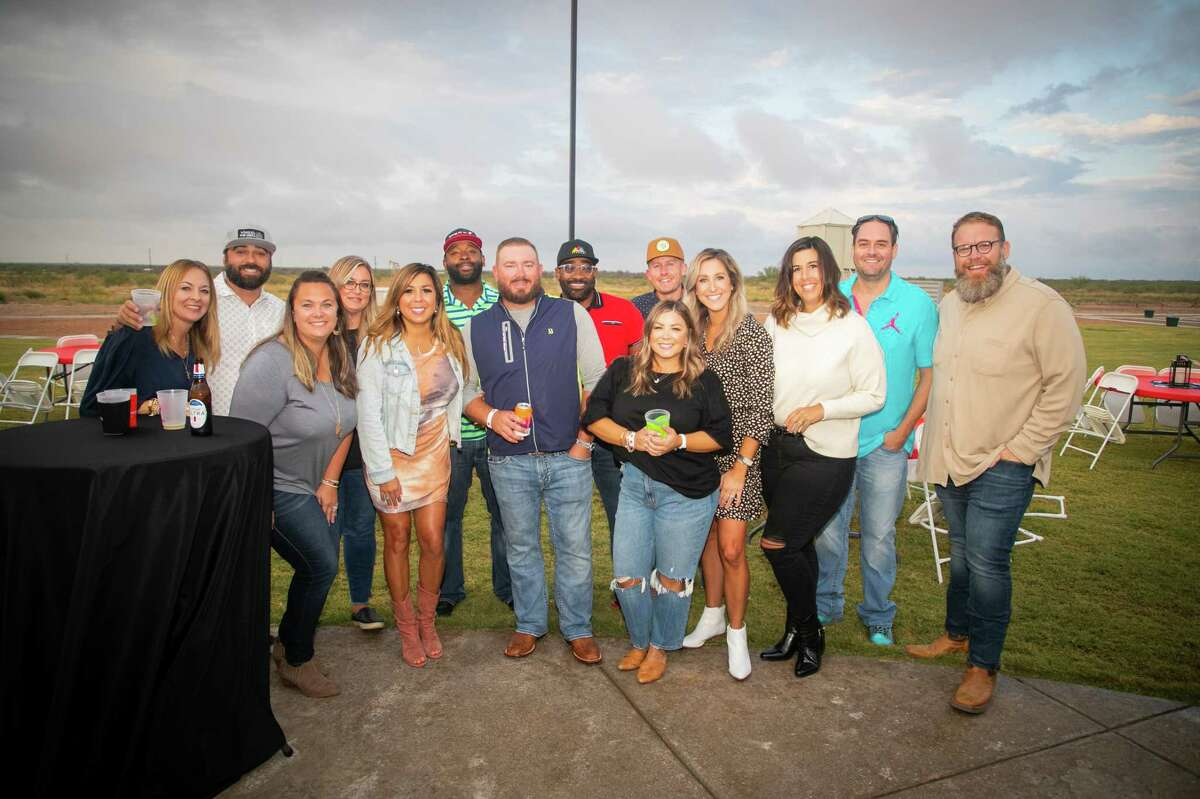 """Participants in the event in group photo """"West Texas Festival"""";  a beer, wine and spirits tasting benefiting the Ellen Noel Art Museum took place on October 1, 2021 at the Midland Shooters Association Shotgun Range clubhouse.  MANDATORY CREDIT: The Oilfield Photographer, Inc."""