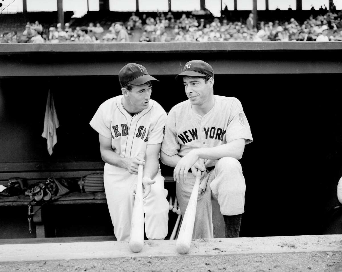 The Red Sox's Ted Williams, left, and the Yankees' Joe DiMaggio chat after a game on Aug. 18, 1942.