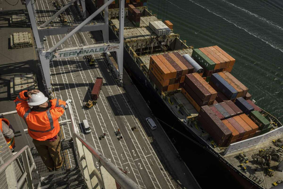 The Long Beach Express cargo ship has its cargo offloaded at the Port of Oakland on Thursday.