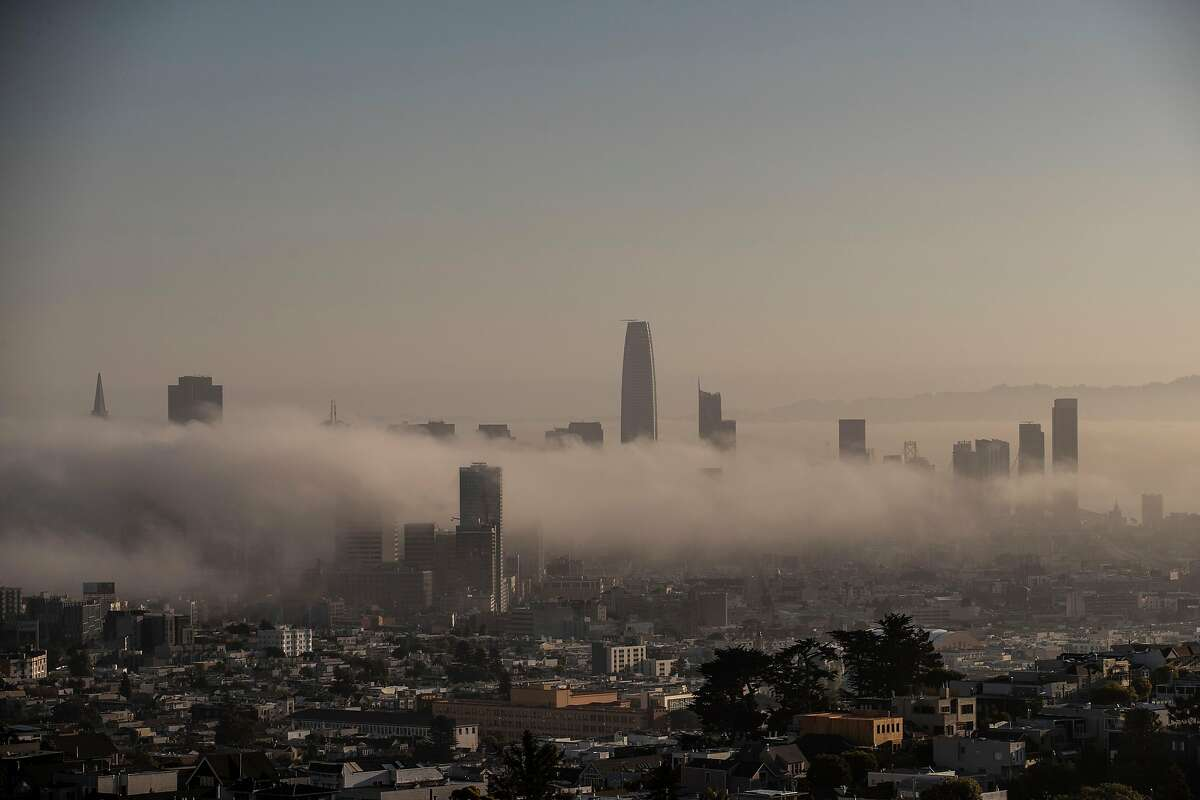 Downtown San Francisco is seen surrounded by a blanket of fog in San Francisco, California Tuesday, Sept. 14, 2021.