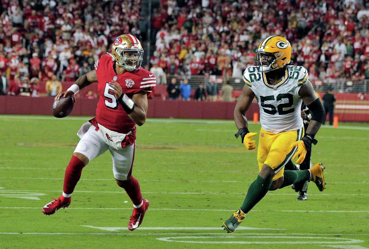 Trey Lance (5) scrambles looking for a reciever in the end zone in the second half as the San Francisco 49ers played the Greenbay Packers at Levi's Stadium in Santa Clara, Calif., on Sunday, September 26, 2021.