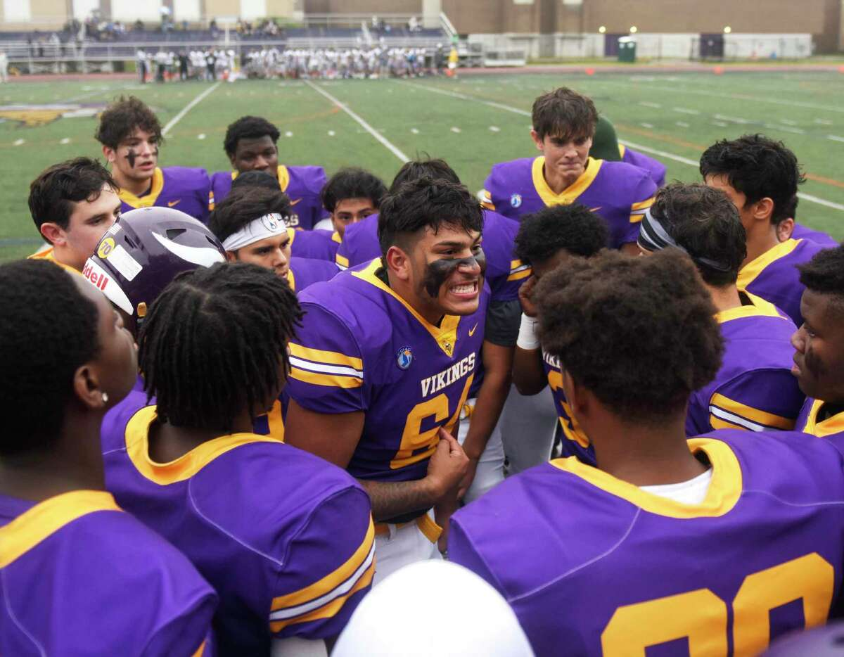 Senior captain Carlos Escobar leads his team in their first football game since the death of fellow teammate Jordan Martinez at Westhill High School in Stamford, Conn. Monday, Oct. 4, 2021. Martinez, a senior, died in a single car crash in Greenwich on Sept. 25. He was honored by fans and teammates at Westhill's game against Amity on Monday, the team's first game since his death.