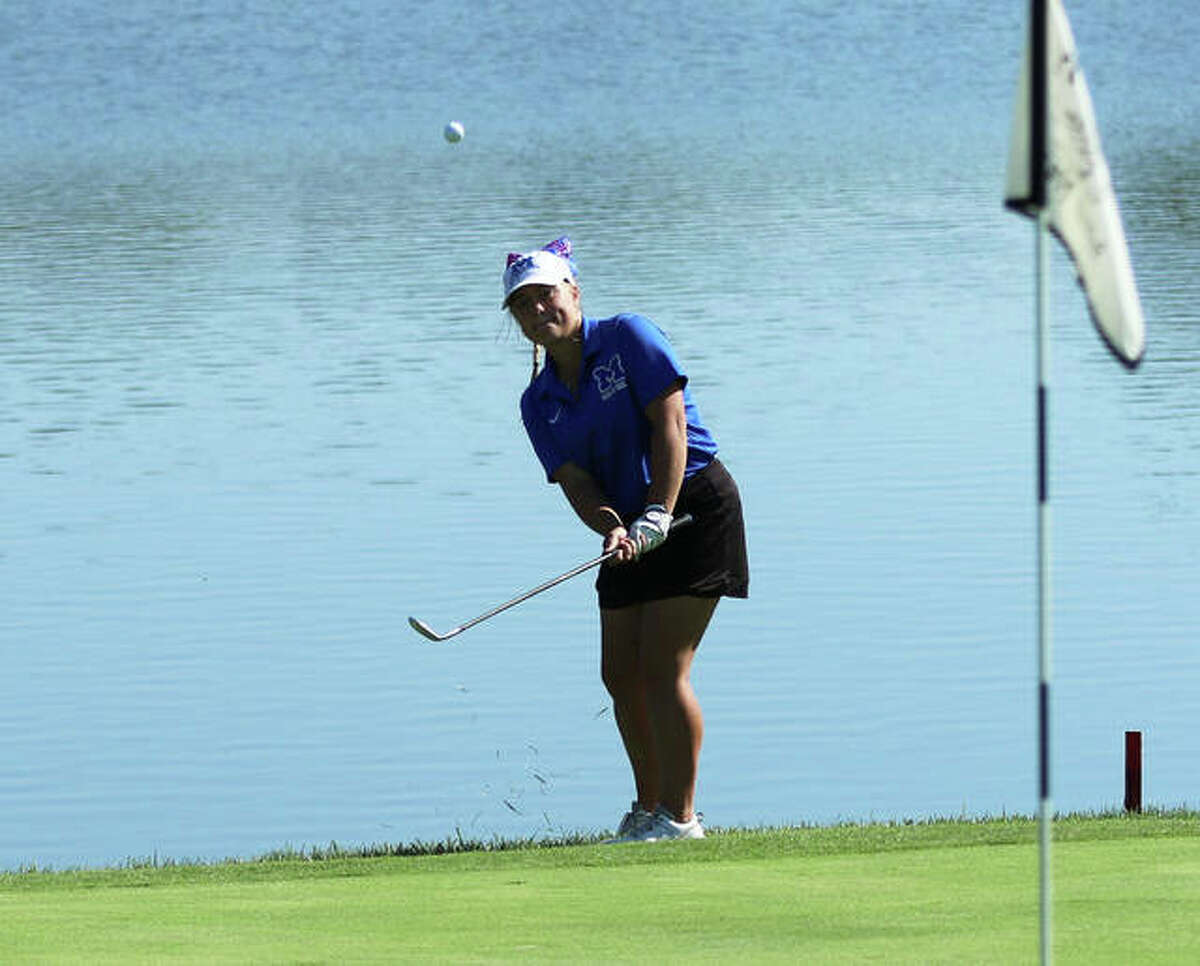 Marquette Catholic's Audrey Cain chips onto the green to set up a par putt on hole No. 10 at Acorns Golf Links on Monday in the Gibault Class 1A Sectional in Waterloo. Cain shot 79 to finish eighth in the tourney.