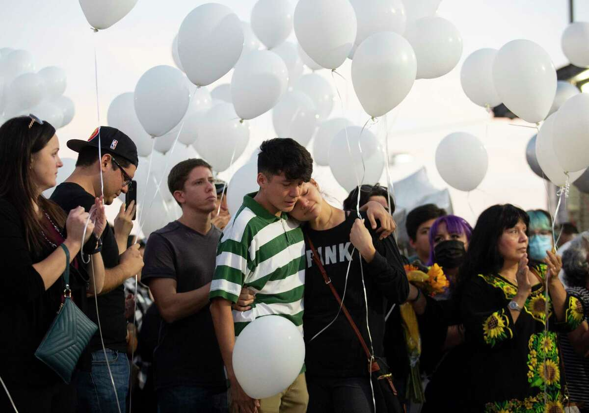 People gather for a balloon launch in memory of valets Fnan Measho, Eric Orduna and Nick Rodriguez, who worked for the bar Prospect Park, Monday, Oct. 4, 2021, in Houston. The 17-year-old driver Ahmedal Modawi killed the three valets in a deadly crash following a police pursuit.