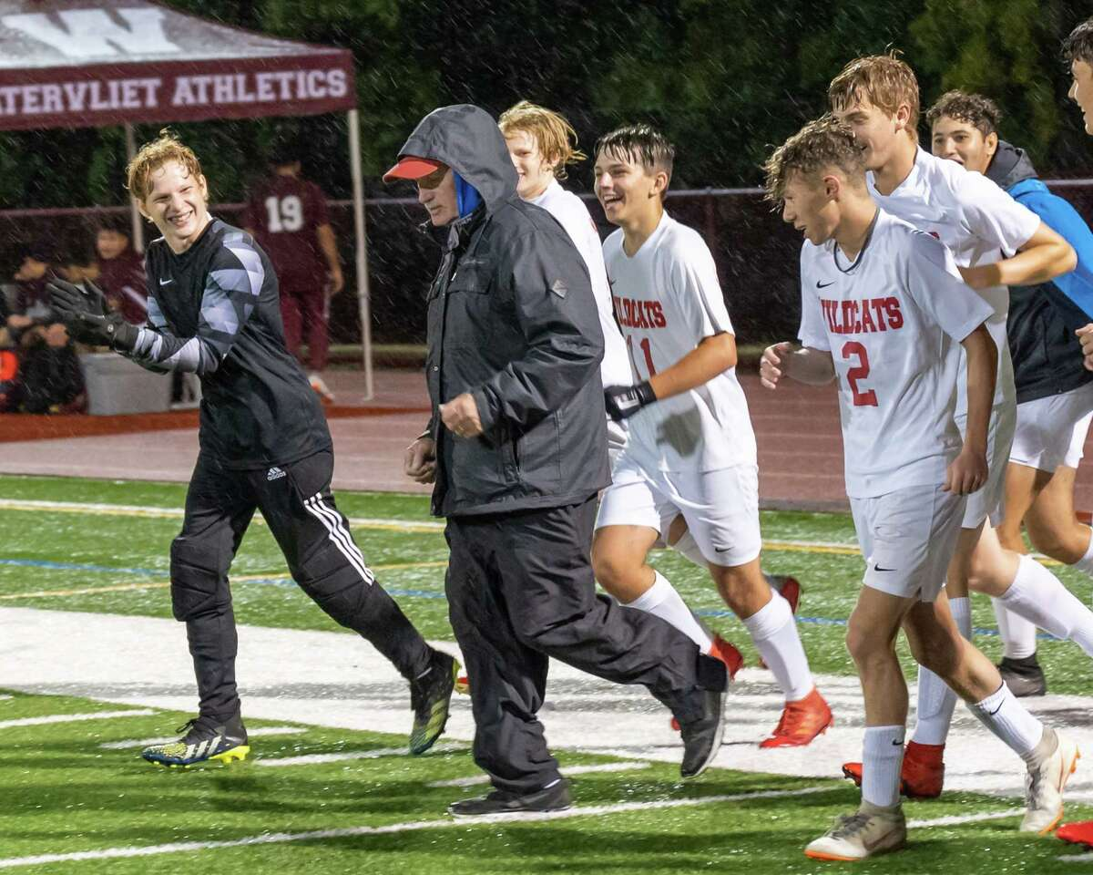 Maple Hill head coach Dan Gillespie runs the field with his team after a game against Watervliet at Watervliet High School on Monday, Oct. 4, 2021. Maple Hill won the game 5-0 giving Gillespie his 700th career win. (Jim Franco/Special to the Times Union)