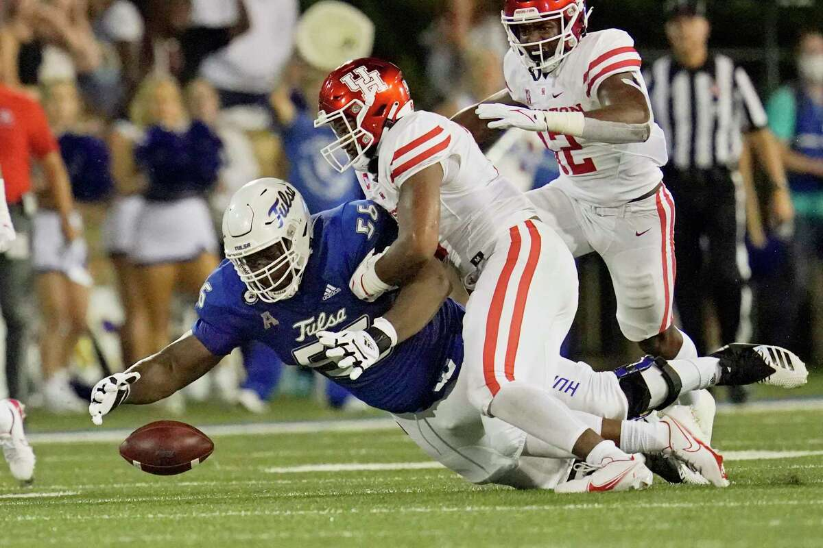 Linebacker Deontay Anderson, center, and his UH teammates have been adept at forcing turnovers this season.