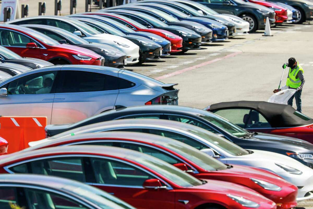 A man cleans the parking lot at the Tesla car factory on Monday, May 11, 2020 in Fremont, California. A federal court jury on Monday awarded $136.9 million to a Black former factory worker at the plant who said he was repeatedly called racist names, shown racist cartoons and subjected to abuse during 9 1/2 months of employment at the electric car company.