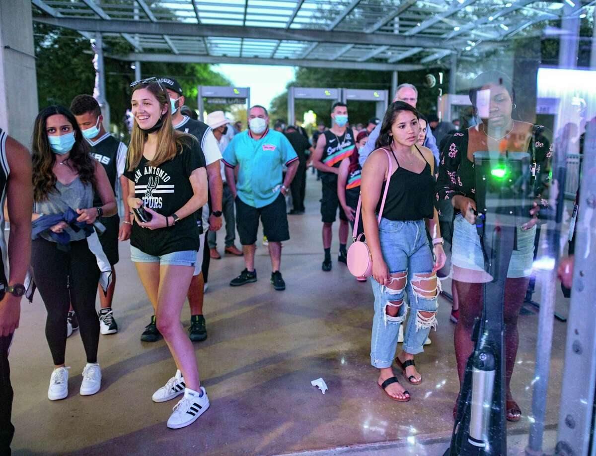 San Antonio Spurs fans arrive at the AT&T Center for the team's exhibition game against the Utah Jazz on Monday, Oct. 4, 2021.