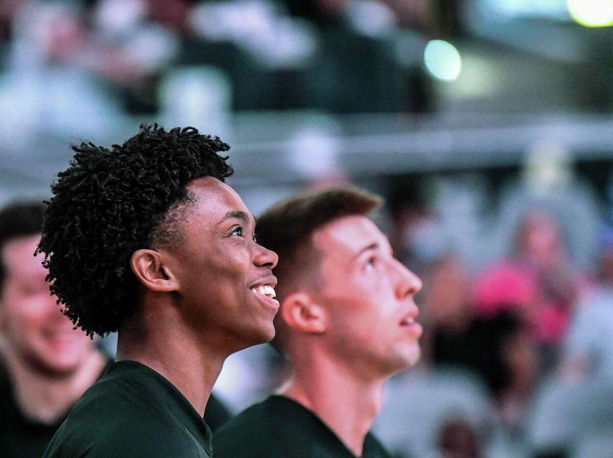 San Antonio Spurs rookies Josh Primo, left, and Joe Wieskamp watch the pregame promo video on the scoreboard screen before their preseason game against the Utah Jazz in the AT&T Center on Monday, Oct. 4, 2021. Primo would score 17 points in the game.