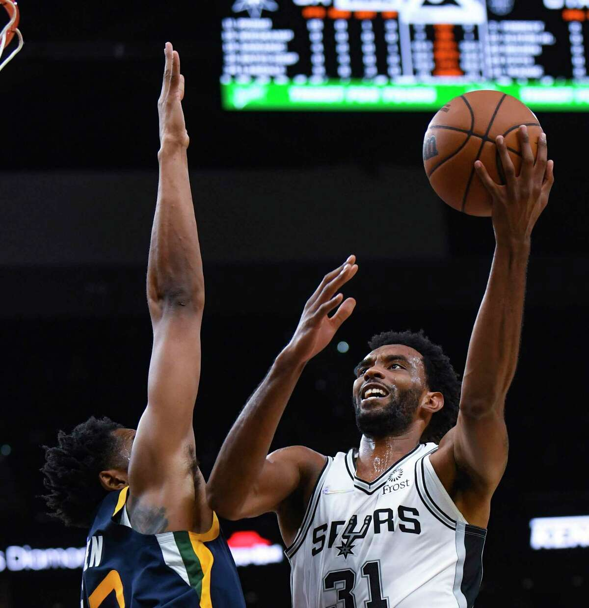 Keita Bates-Diop of the San Antonio Spurs shoots and scores during NBA preseason action in the AT&T Center on Monday, Oct. 4, 2021.