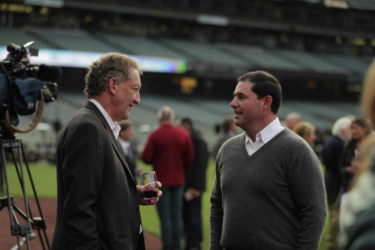 San Francisco Giants CEO Larry Baer speaks with 49ers CEO Jed York during the Bay Area Sports Hall of Fame induction ceremony at Oracle Park in San Francisco, Calif., on Monday, October 04, 2021.