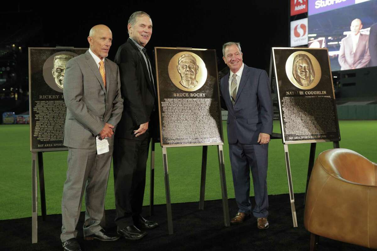 Former Giants manager Bruce Bochy unveils his plaque with Tim Flannery snd Mario Alioto during the Bay Area Sports Hall of Fame induction ceremony at Oracle Park in? San Francisco, Calif., on Monday, October 04, 2021.