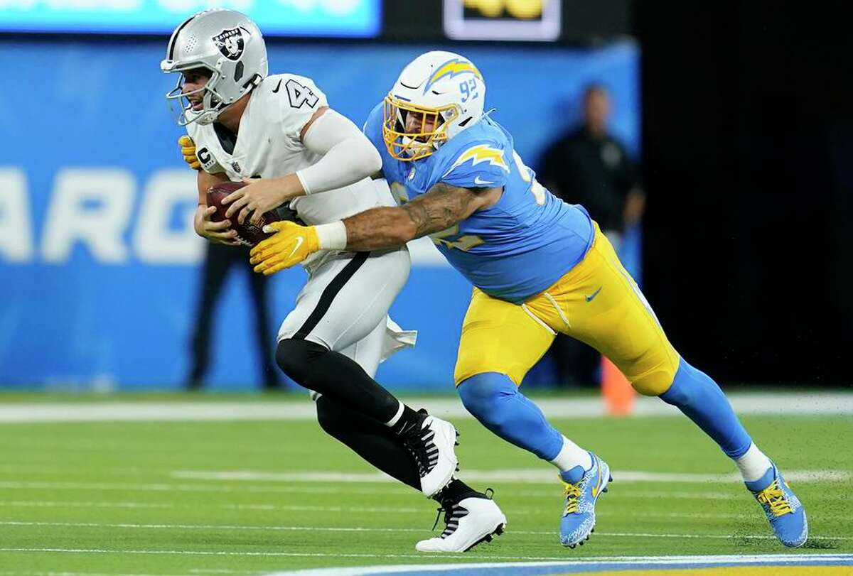 Chargers defensive end Joe Gaziano hauls down Raiders quarterback Derek Carr for a sack during the second half.