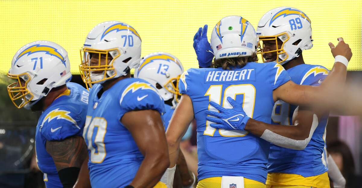 Tight end Donald Parham #89 of the Los Angeles Chargers celebrates his touchdown with teammate quarterback Justin Herbert #10 against the Las Vegas Raiders during the first quarter at SoFi Stadium on October 4, 2021 in Inglewood, California. (Photo by Harry How/Getty Images)