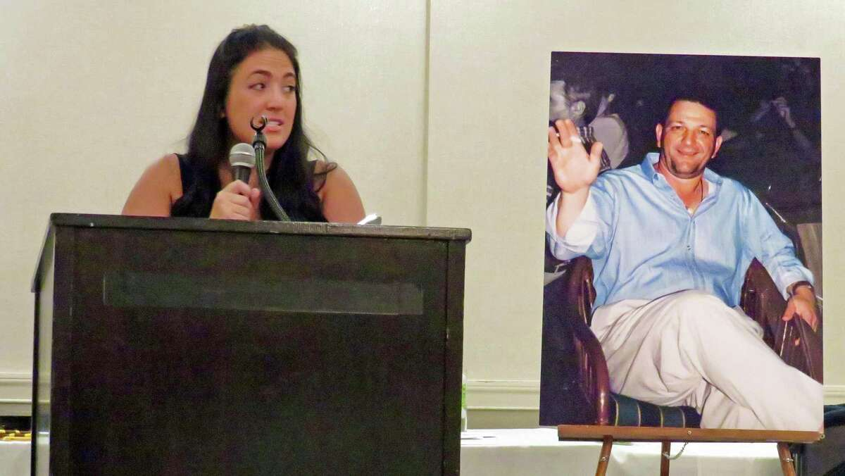 Branford's Kathryn Malerba regaling the crowd at Grassy Hill Country Club with tales of her father Vincent Malerba, who died in June 2020.
