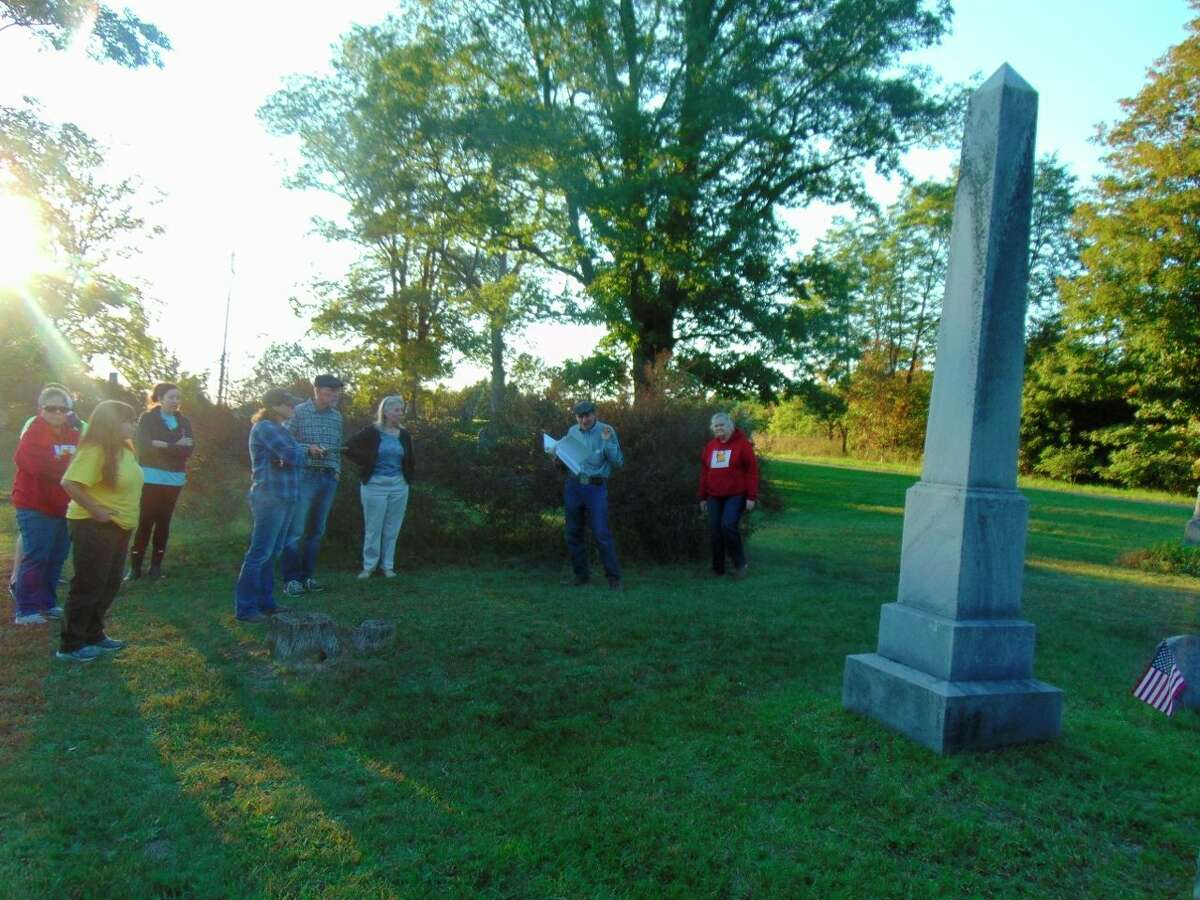 Sid Woods pointed out the largest stone in the Chase Township Cemetery, that of George Oviatte, early sheriff, state representative and owner of the newspaper, The Chase Eclipse. (Star photo/Shanna Avery)