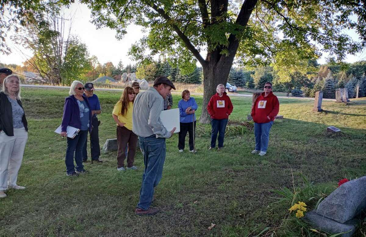 Sid Woods guided the group through the oldest section of the cemetery. (Star photo/Shanna Avery)