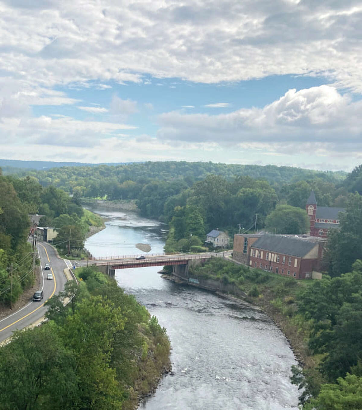 Bikers enjoy beautiful views along the Empire State Trail, including of the Rondout Creek pictured here.