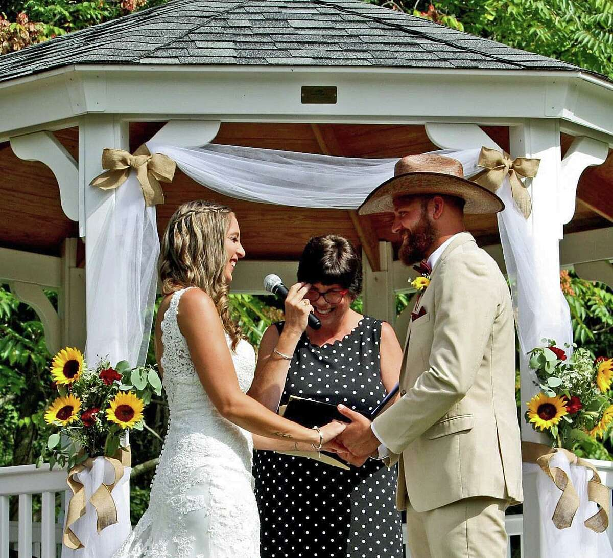 Mollie Hull and Kyle Hendrix exchange their wedding vows in front of the gazebo at the Martin-Bishop Memorial Field with Veronica Wallace officiating.