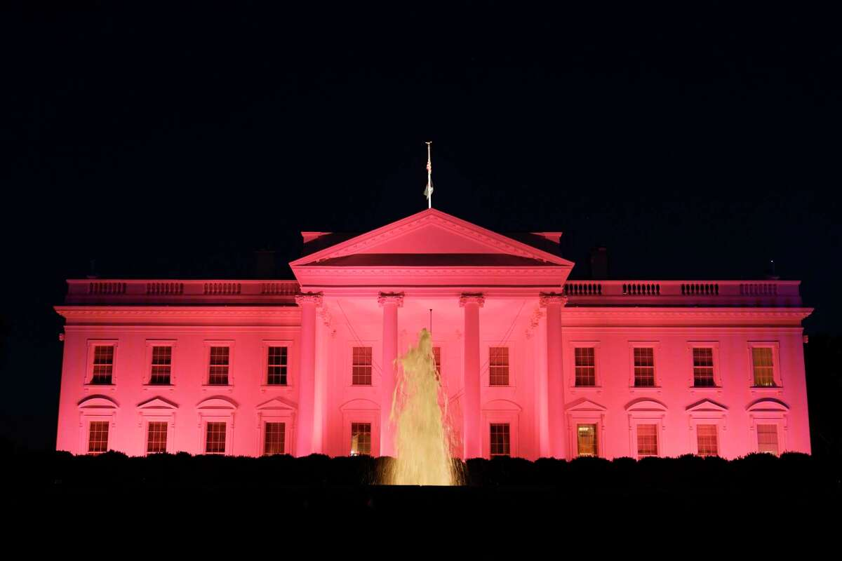 The White House in Washington, Friday, Oct. 1, 2021, is illuminated in pink light in recognition of Breast Cancer Awareness month.