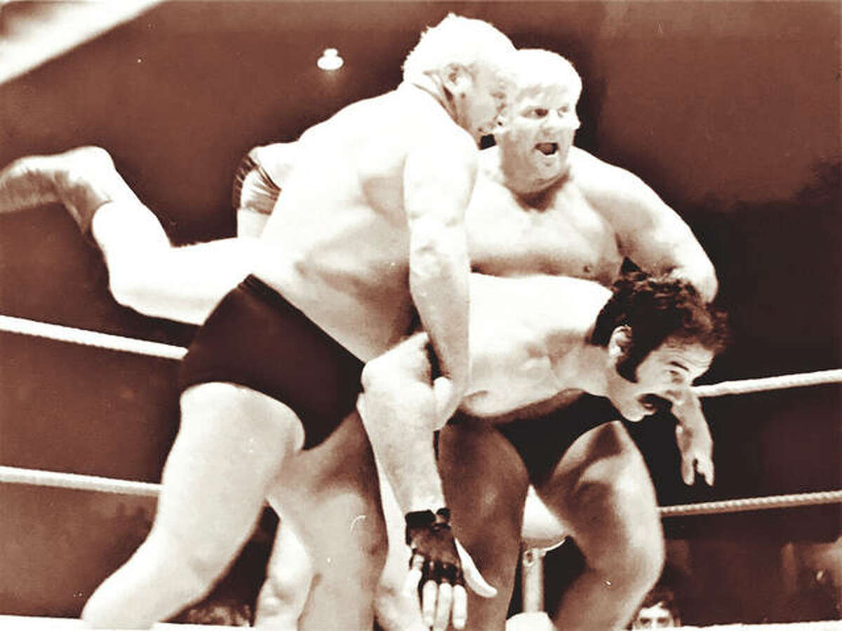 """Bobby the Brain Heenan and Dick The Bruiser about to give Black Jack Lanza a little ride while wrestling at the Chase Park Plaza's Khorassan Room in St. Louis. """"Wrestling at the Chase"""" premiered in 1959, shot live on Saturday nights and rerun on Sunday mornings. Ed Wheatley has written a coffee-table book """"Wrestling at the Chase"""" about the famed show."""