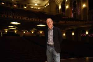 David Alan Miller, conductor and music director of the Albany Symphony Orchestra, stands on the state at the Palace Theatre on Monday, Oct. 4, 2021, in Albany, N.Y.