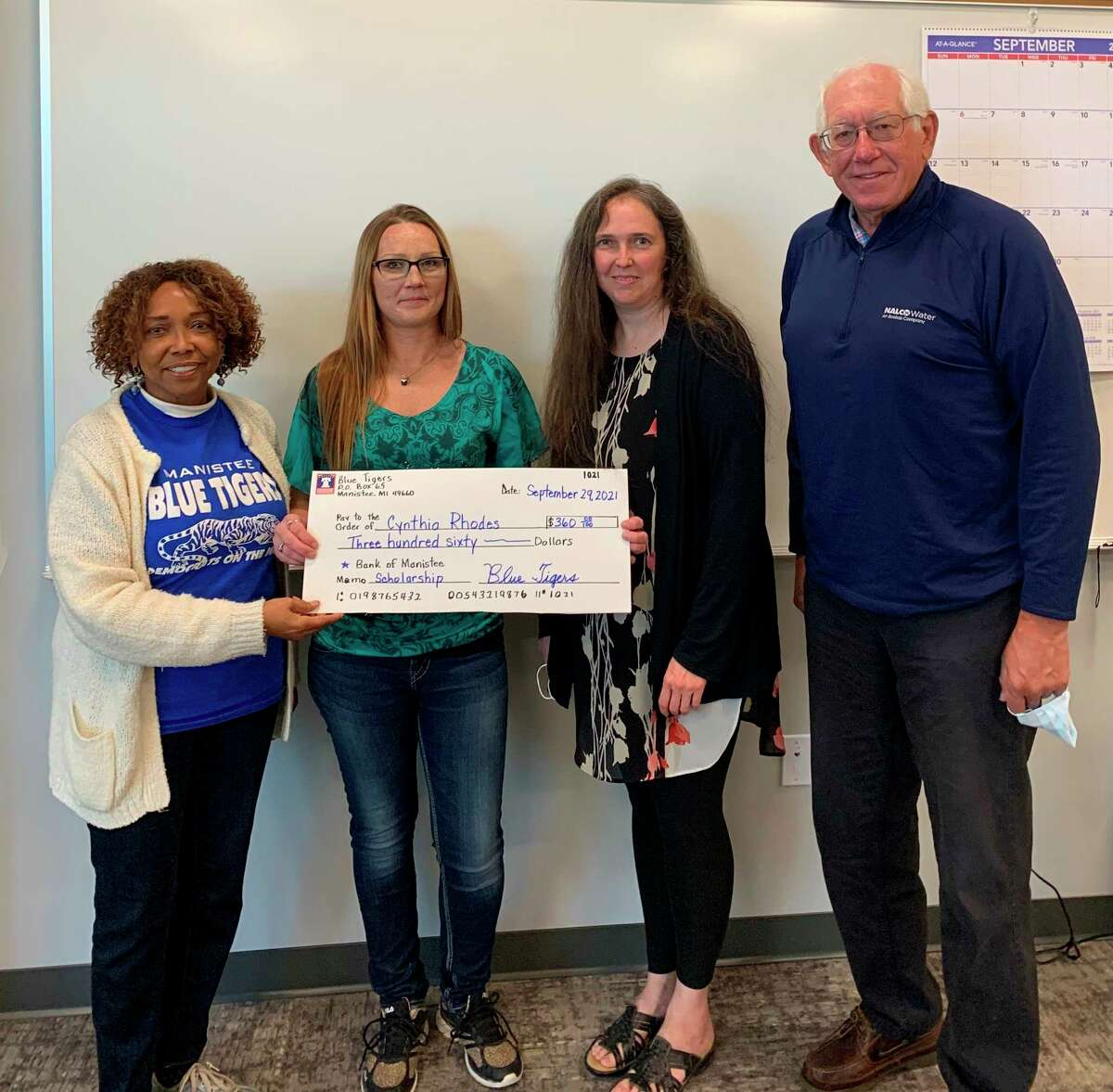Pictured (from left) are Shirley Madden, Blue Tigers chairperson; Cynthia Rhodes;Maryann Allen, of Northwest Michigan Works!; and John Helge, Manistee County Democrats chairperson. Rhodes received a scholarship from the Blue Tigers to assist her with transportation to the Manistee Northwest Michigan Works! site at 400 River St. in Manistee, where she is working to complete her GED. (Courtesy photo)