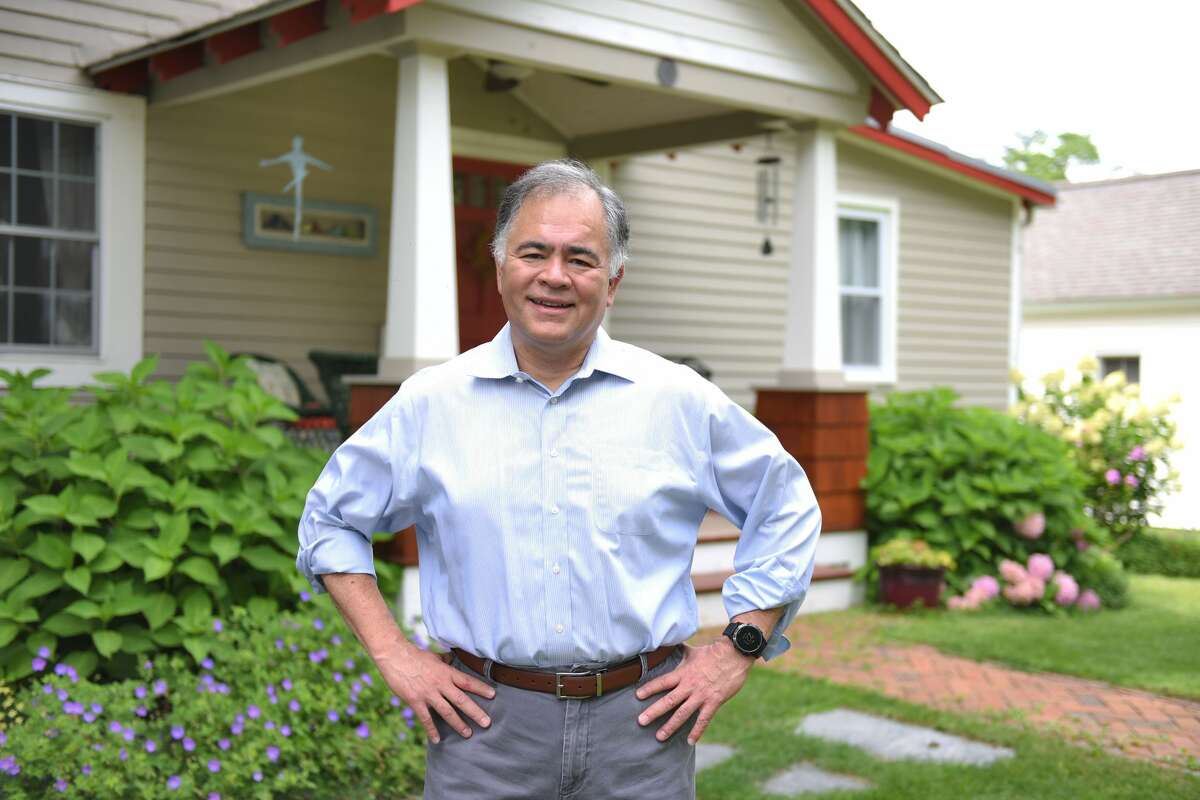 Saratoga Springs mayoral candidate Ron Kim stands in front of his home where the GOP claims he doesn't live.