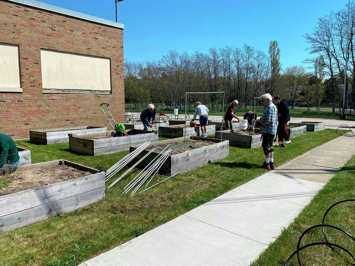 Members of the Spirit of the Woods Garden Club, Inc.preparedthe garden beds with trellises and new drip hose irrigation at the Armory Youth Project. (Courtesy photo)