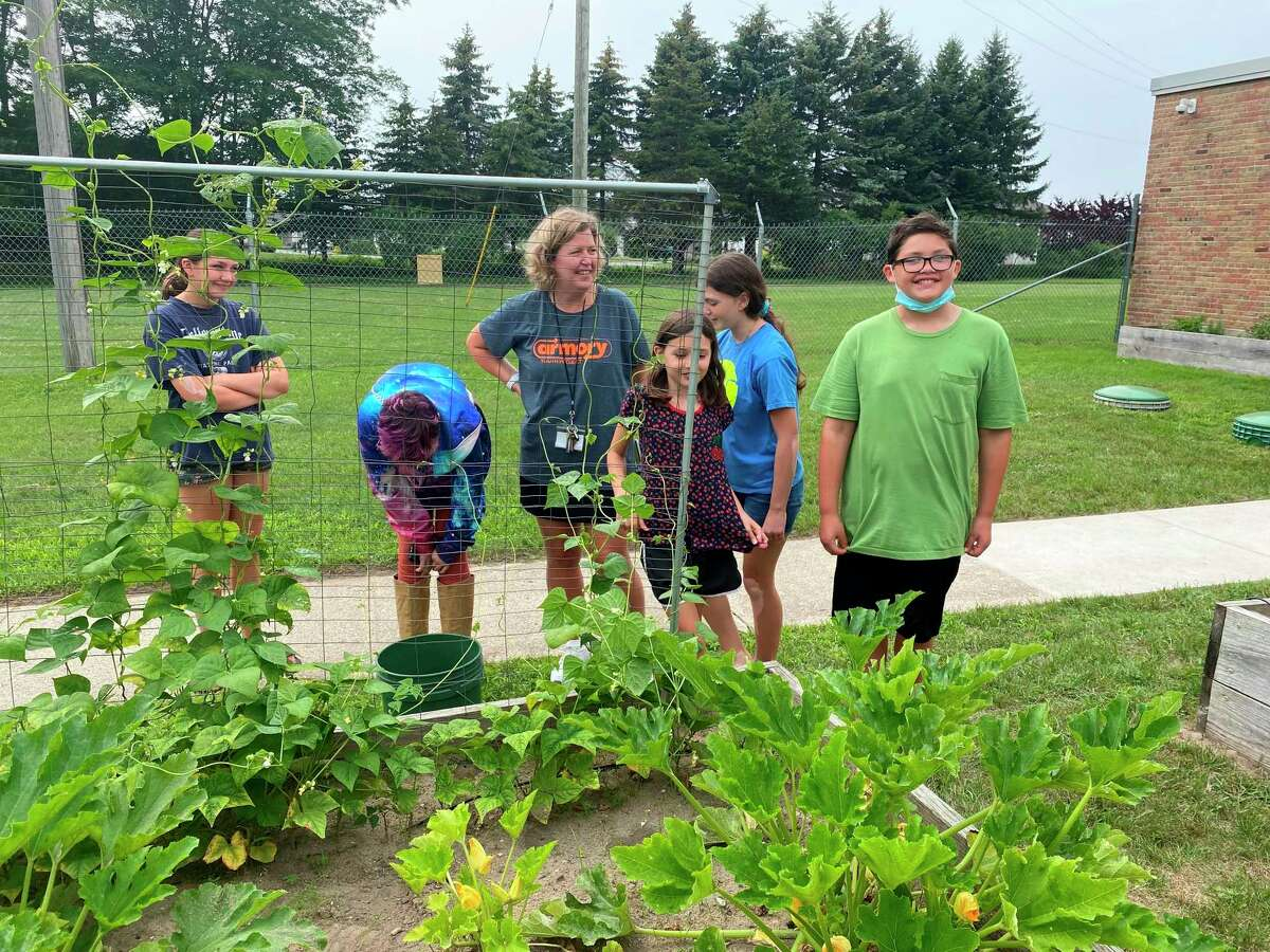 Some of the students at the Armory Youth Project picked Japanese beetles off the plants with Theresa Anderson, assistant executive director forthe Armory. (Courtesy photo)