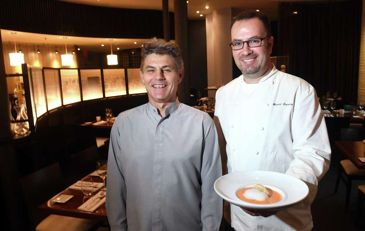 Olea manager Juan Gonzalez, left, is photographed with executive chef and co-owner Manuel Romero in New Haven in 2016.