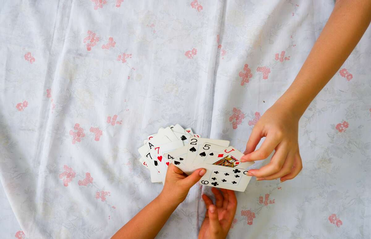 Sometimes children enjoy the simple things the most, like playing a card game during a trip.