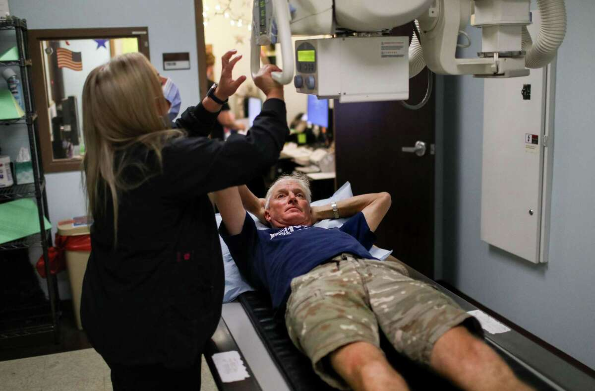 Stuntman Tommy Goodwin, who broke his pelvis in a horseback-riding accident at his home in Wharton County, prepares for X-rays taken by radiology technician Tiffany Bryant at an outpatient clinic in Houston.