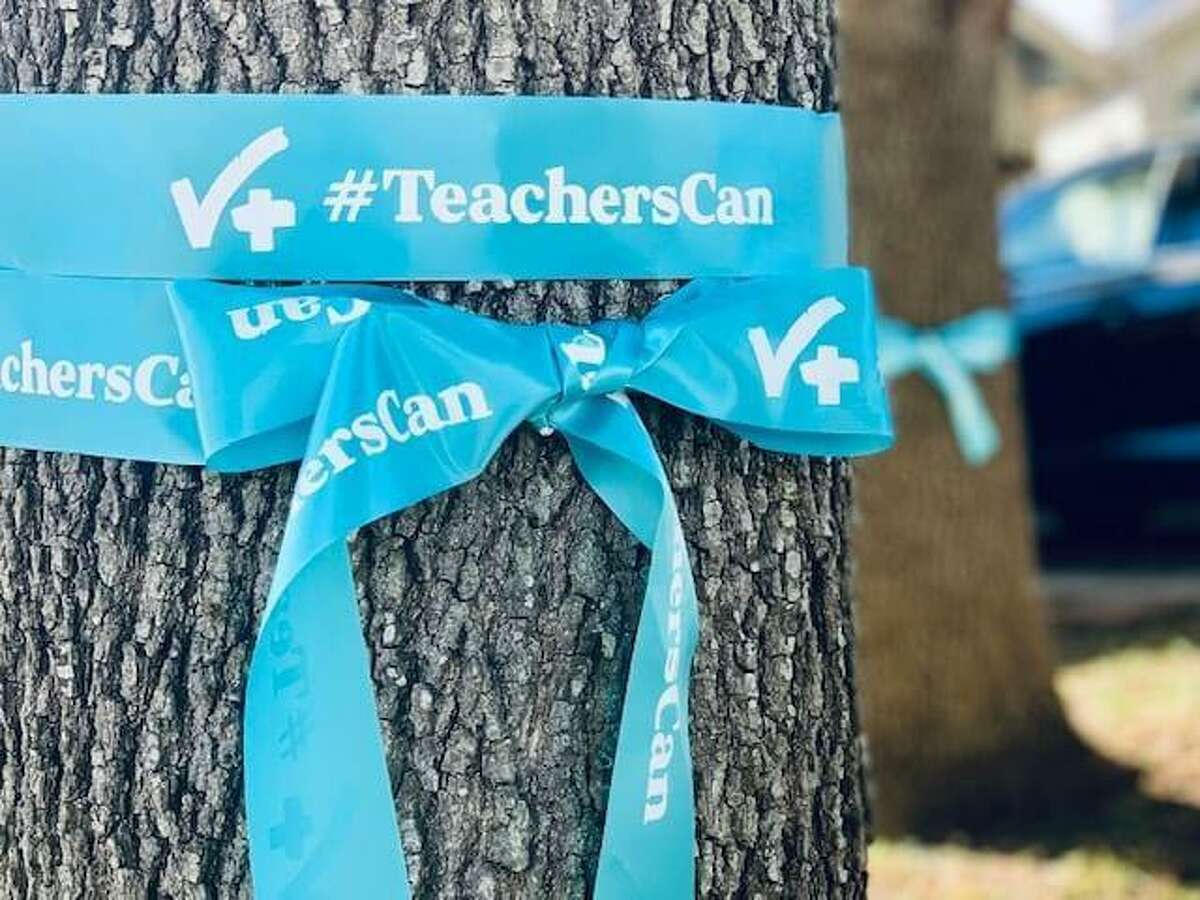 Blue ribbons like this one will adorn trees and columns in downtown San Antonio to celebrate World Teachers' Day, and blue lights will illuminate landmarks there tonight.