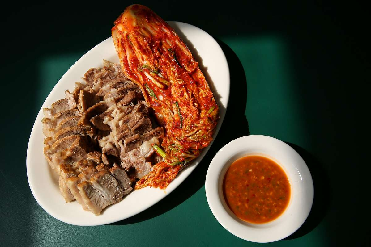 Korean suyuk, boiled pork with Napa cabbage kimchi, is on the new dine-in menu at Queens in San Francisco.