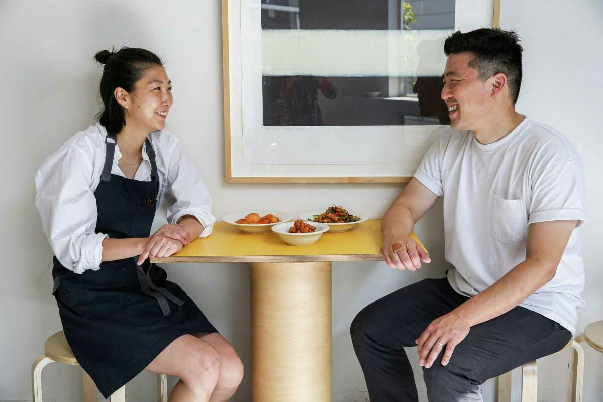 Queens owners Clara Lee, left, and Eddo Kim are bringing a dining menu to their market for the first time in hopes of educating patrons more about Korean cuisine.