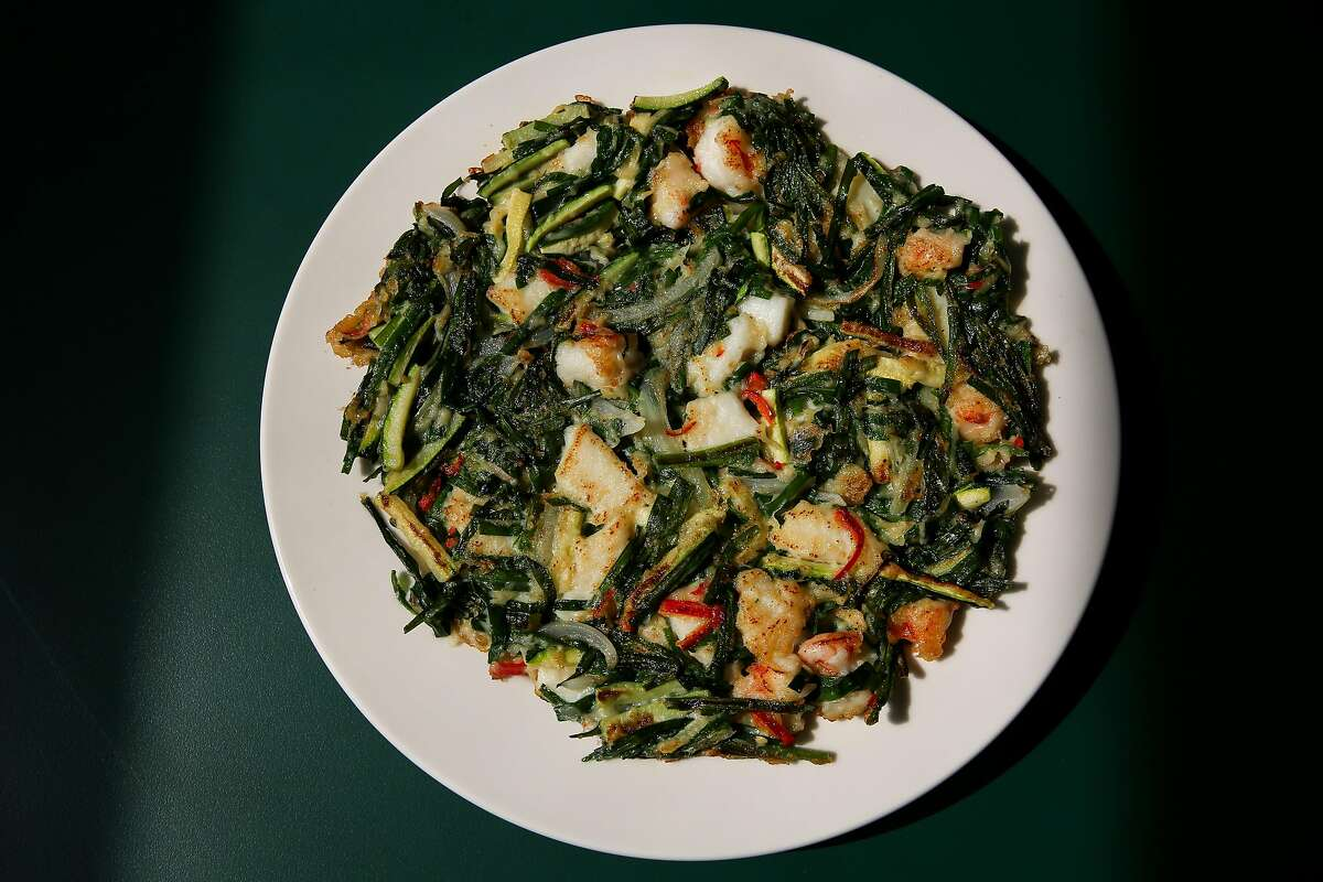 Haemul buchu jeon, a savory pancake with shrimp, squid, garlic chive and squash, will be on Queens' new dine-in menu.
