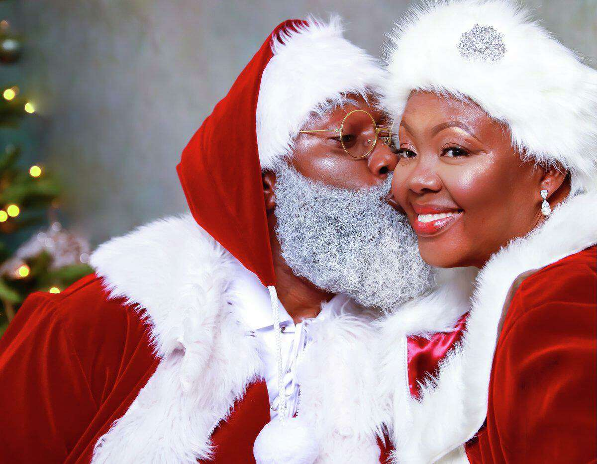 BLACK SANTA: The Black Santa Houston debuts his wife of 400 years, Mrs. Black Santa Houston. They'll be making the rounds for the holidays.