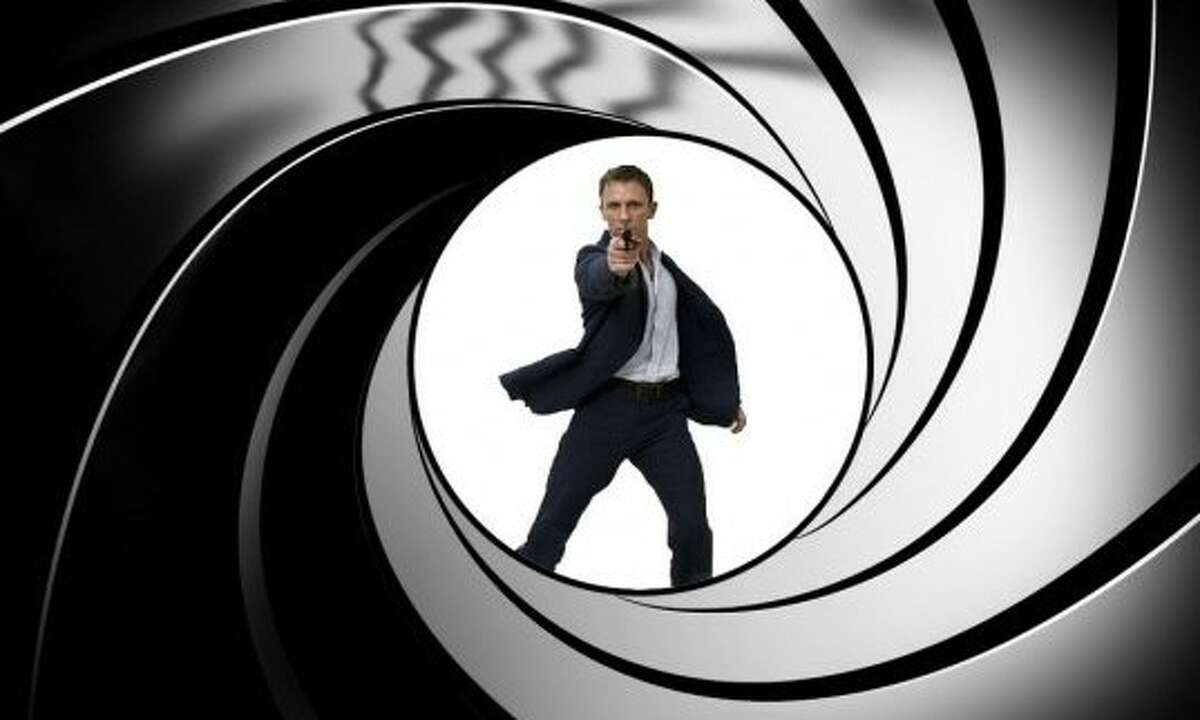 """Daniel Craig takes aim for the last time as James Bond in """"No Time to Die,"""" the 25th official 007 movie and the 27th overall."""
