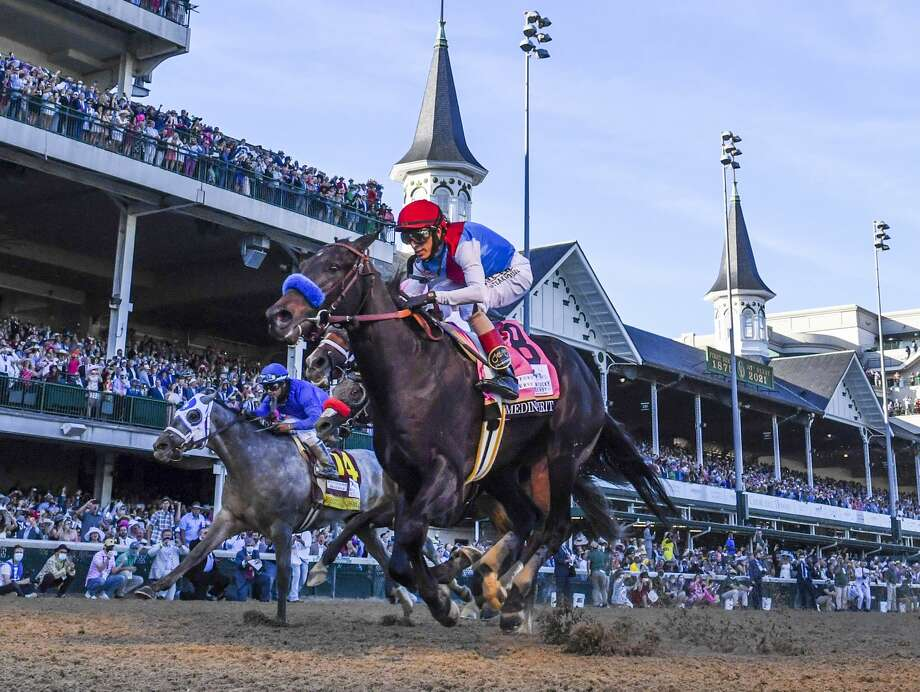Medina Spirit with jockey John Velazquez aboard wins the 147th running of The Kentucky Derby at Churchill Downs Race Track Saturday May 1, 2021 in Louisville, Kentucky. Photo Special to the Times Union by Skip Dickstein Photo: Skip Dickstein / Skip Dickstein 2021