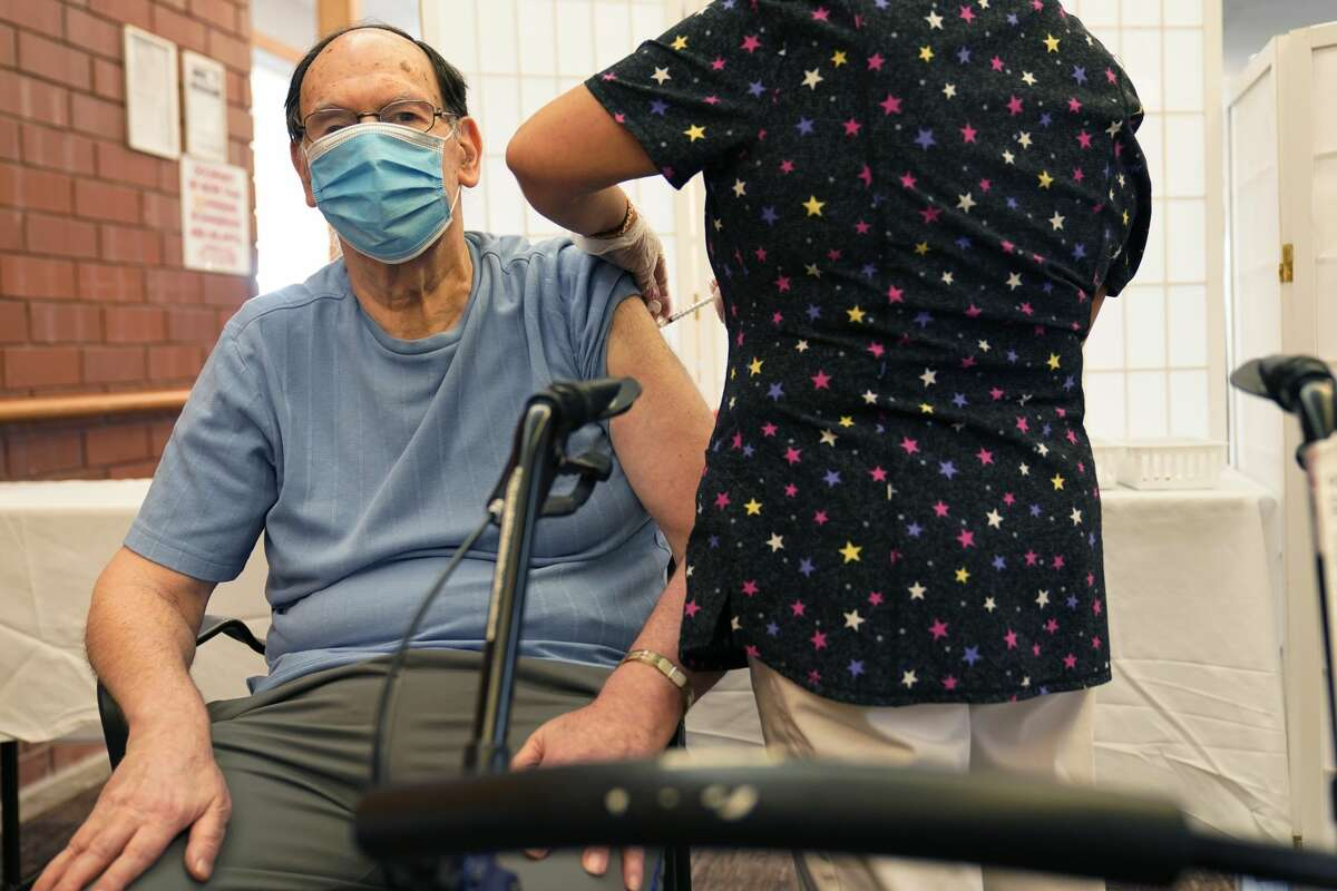 Marvin Marcus, 79, a resident at the Hebrew Home at Riverdale, receives a COVID-19 booster shot in New York, Monday, Sept. 27, 2021. (AP Photo/Seth Wenig)