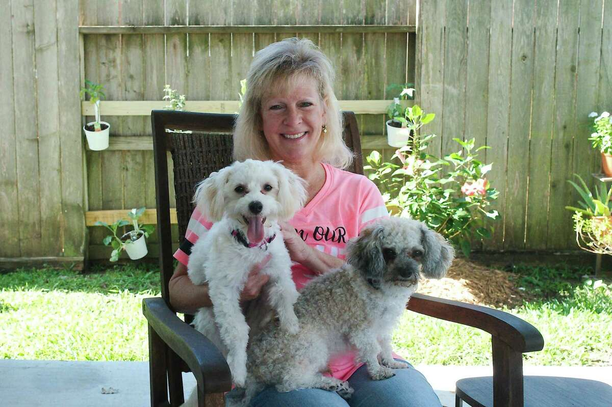 """Danielle Fish of Pearland savors aspects of life such as taking daily walks and spending time with her dogs. After undergoing chemotherapy and a bilateral mastectomy following a 2015 diagnosis of an aggressive form of breast cancer, the 55-year-old retired teacher says she's worked hard to get where she is today. """"I'm in a much better emotional place than I was,"""" she says."""