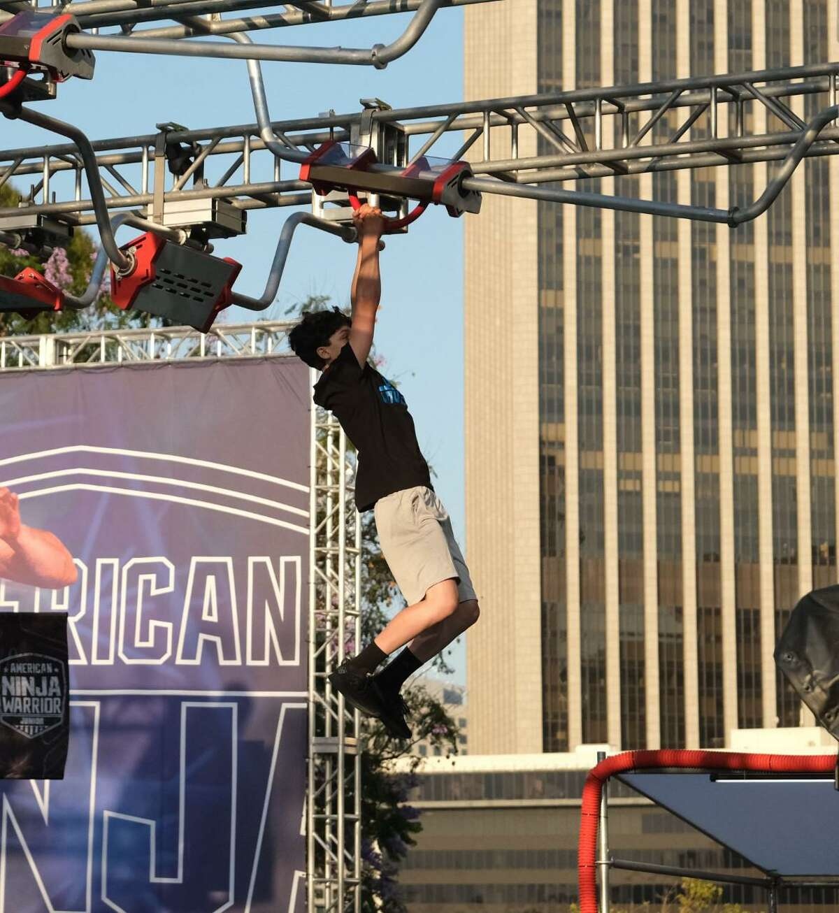 Milford teen Collin Cella competing in this year's American Ninja Warrior Junior.