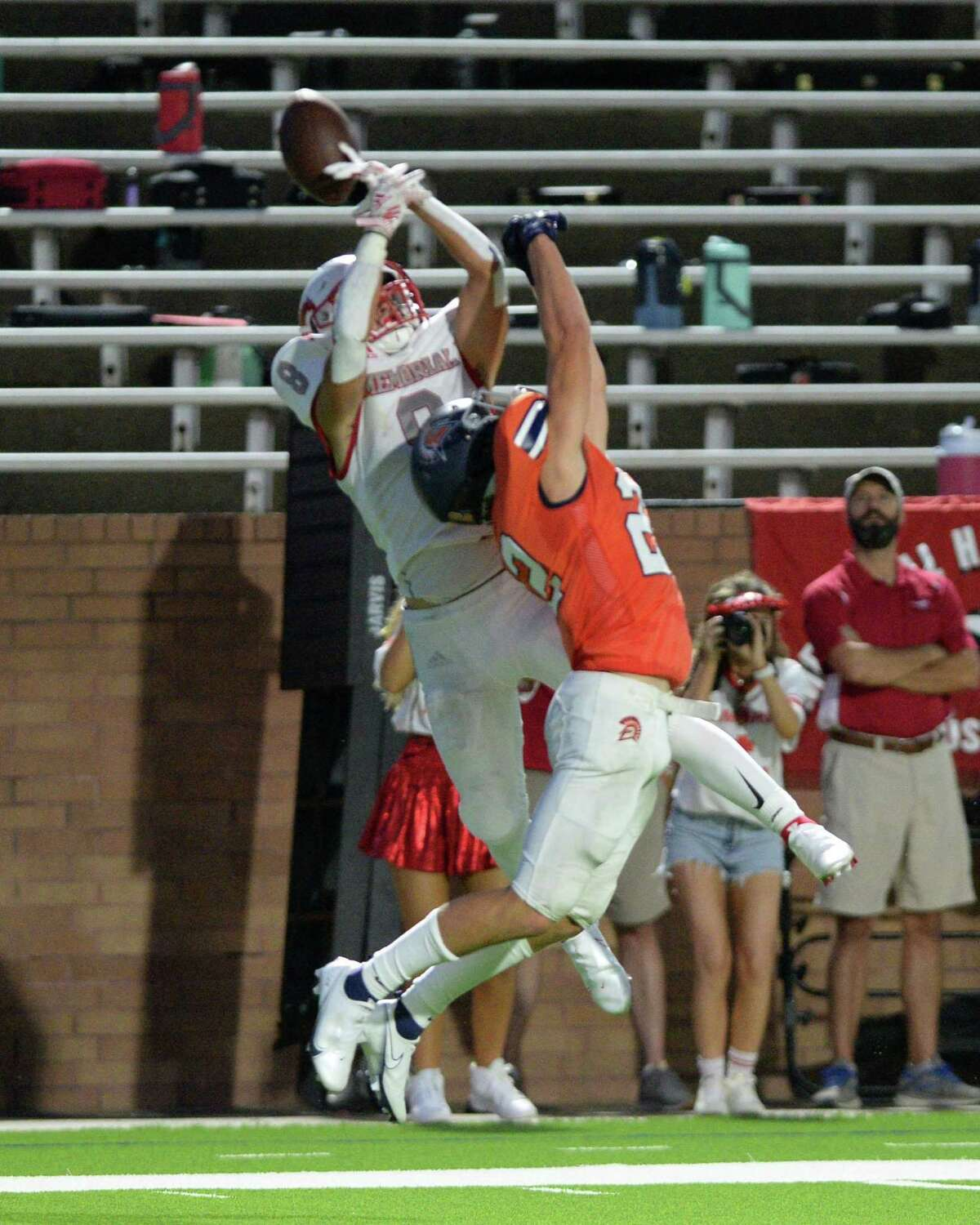 Bryce Turner (22) of Seven Lakes breaks a pass intended for Trent Posell (8) of Memorial during the second quarter of a non-District football game between the Seven Lakes Spartans and the Memorial Mustangs on Friday, August 27, 2021 at Rhodes Stadium, Katy, TX.