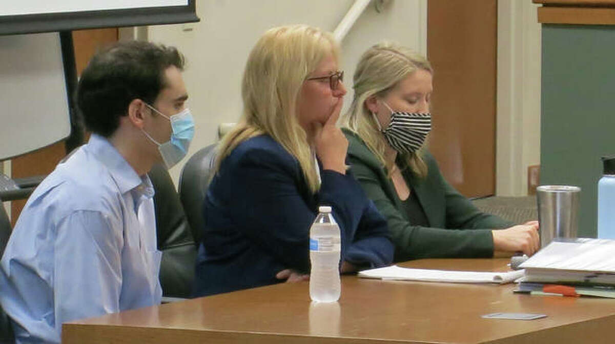 Timothy Banowetz, left, and his public defenders Mary Copeland, center, and assistant public defender Delani Hemmer listen to the prosecution's case.