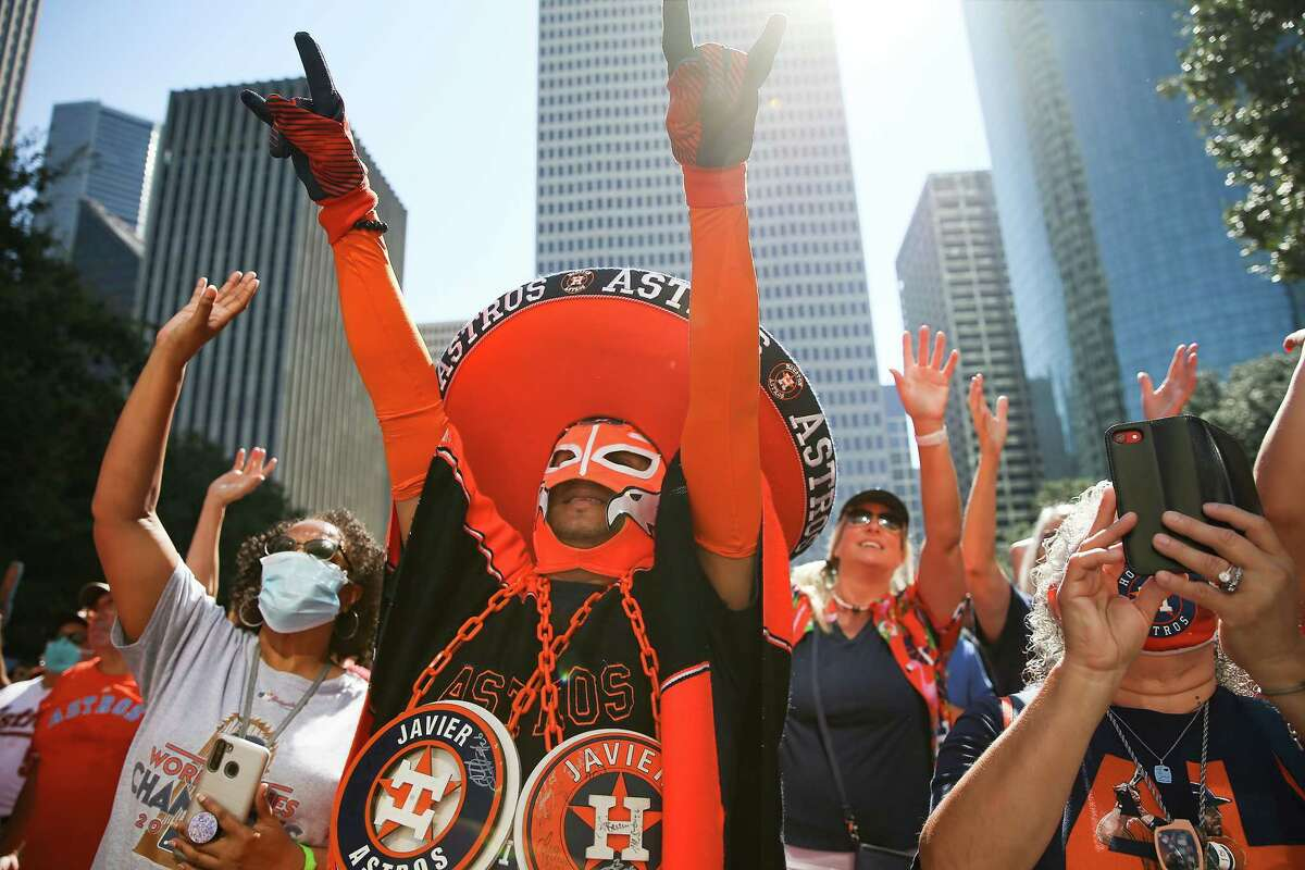 Astros fan Javier Esparza cheers during the City of Houston's rally for the Houston Astros and their AL West Division Championship in Houston on Tuesday, Oct. 5, 2021. The Astros take on Chicago White Sox at 3:07 pm Thursday to kick off their playoff series.